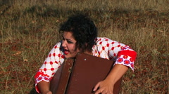 Crazy Dark Haired Woman With Suitcase At The Meadow At Nature Stock Footage