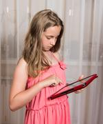 Girl with tablet pc at home - stock photo