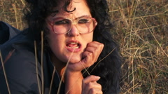 Serious Plus-Sized Woman In Black Lying At The Meadow At Nature - stock footage
