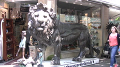 Lion statue in shopping district in central Cologne Stock Footage
