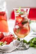 Misted glass with strawberry refresh cocktail Stock Photos