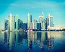 Vintage retro hipster style travel image of Singapore skyline of business dis Stock Photos