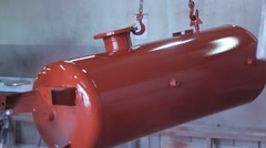 Painting a vessel with red colour Stock Footage