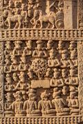 Stock Photo of Gateway decoration bas relief of Great Stupa - ancient Buddhist monument. San