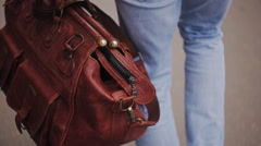 A man with a brown bag goes on the road Stock Footage