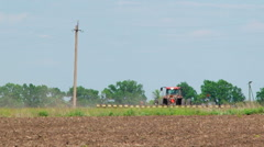 Tractor With Seeder Sowing Crops In The Field Stock Footage