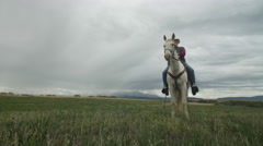 Senior cowboy on Horse -Front- Dolly Left Stock Footage