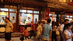 People on the Wangfujing snack street in Beijing Stock Footage