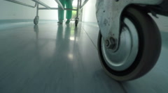 Low level close up of medical professional bed wheel moving on hallway Stock Footage