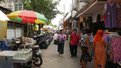 Market street, cloth and dress shop, motorbike parked Stock Footage