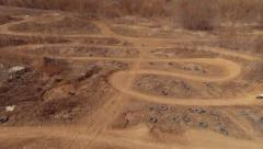 Aerial overview of the motocross track. Three riders on the track. Stock Footage
