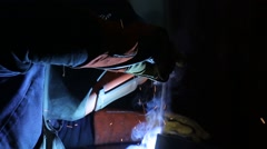 Welding operator with a mask - stock footage