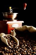 Overturned sack full of coffee beans isolated on black with spatula and winno Stock Photos