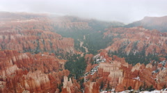 A Time Lapse Of Winter Fog going over A Rocky Snow-Capped Canyon. Stock Footage