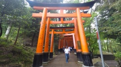 Japanese people and tourists walk Fushimi Inari Shrine in Kyoto. Stock Footage