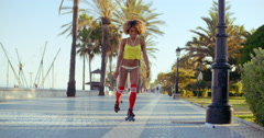 Sexy Roller Girl Skating on Exotic Promenade Stock Footage