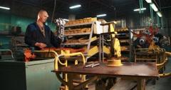 Mechanic working on a motor-blocks Stock Footage