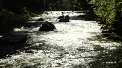 River in back lighting with stones Stock Footage