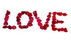 Love inscription from red rose petals Stock Photos