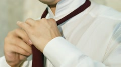 Man tying a tie close up - stock footage