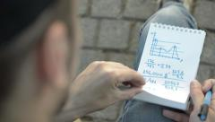 Man turns the page covered with writing pad. Stock Footage