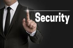 Security touchscreen is operated by businessman - stock photo