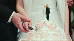 Cutting the wedding cake close-up - stock footage