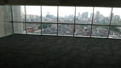 Camera move back from aerial city view in twilight, to empty room - stock footage