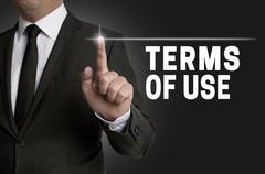 Terms of use touchscreen is operated by businessman - stock photo