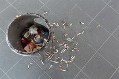 Cigarette butts and ashtray Stock Photos