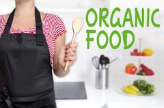 Organic food chef holding wooden spoon background Stock Photos