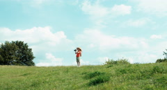 Young naturalist girl through binoculars watching wildlife and looking at camera - stock footage