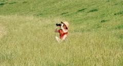 Stock Video Footage of Young naturalist preschooler girl through binoculars watching wildlife