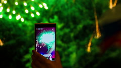 One Person Making A Video Of Fireworks Using Smartphone - stock footage