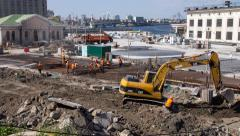 People and machines are working on construction site Timelapse Stock Footage