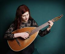 Woman playing lute Stock Photos