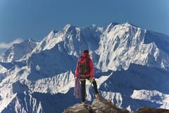 Caucasian hiker admiring scenic view from mountaintop, Monte Rosa, Alps, Italy Stock Photos