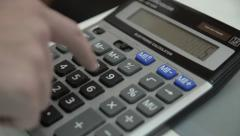 The man said on the calculator. close-up. Stock Footage