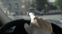 Man beats out the rhythm with your fingers on the steering wheel. Stock Footage