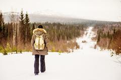 Caucasian man hiking on snowy path Stock Photos