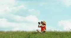 Young naturalist through binoculars watching wildlife - stock footage