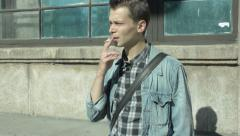 A man smoking a cigarette Stock Footage