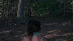 Woman walks in creepy forest barefoot Stock Footage