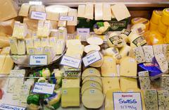 Variety of cheese selling in a market Stock Photos