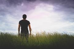 Silhouette of young man - stock photo
