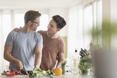 Caucasian gay couple cooking in kitchen Kuvituskuvat