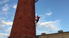 Man climbs the tower Stock Footage