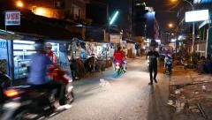 Night busy street in Kebon Kacang district, motorbikes and people Stock Footage
