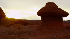 The Sun Sets Over Goblin-Like Rock Formations In A Desolate Valley. - stock footage