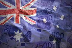 colorful waving australian flag on a euro money background - stock photo